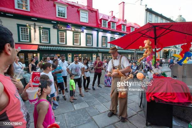 street performers in old quebec city - old quebec stock pictures, royalty-free photos & images