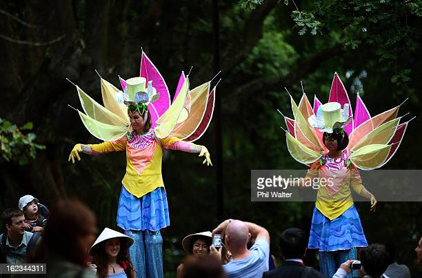 Street performers move amongst the crowd during the Lantern Festival in Albert Park on February 22 2013 in Auckland New Zealand The Auckland lantern...