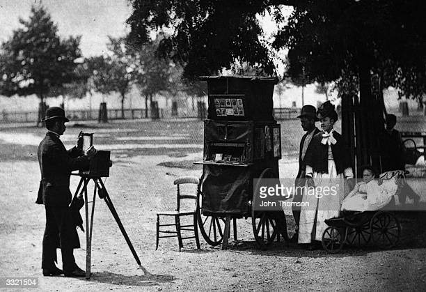 A street photographer at work on Clapham Common London with a mobile booth Original Publication From 'Street Life in London' by John Thomson and...