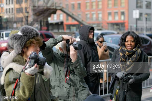 Street photographers take photos of guests outside during New York Fashion Week The Shows at Spring Studios on February 10 2019 in New York City