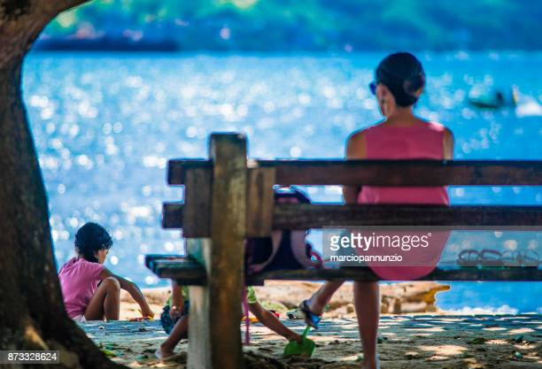 street photography documenting the daily life of the beach in Ilhabela, Brazil