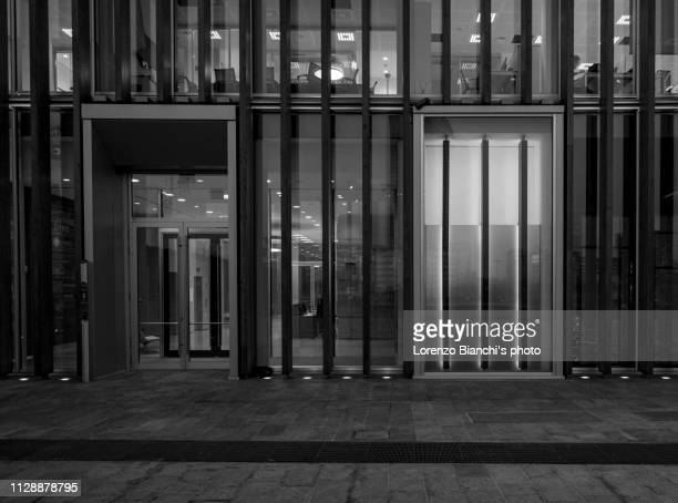 street photography in porta nuova district, milan - black and white instant print stock pictures, royalty-free photos & images