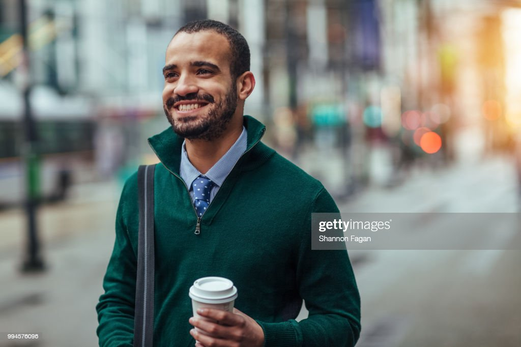 Street portrait of a young businessman : Stock Photo