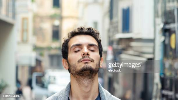 street portrait of millennial man in his 20s - stubble stock pictures, royalty-free photos & images