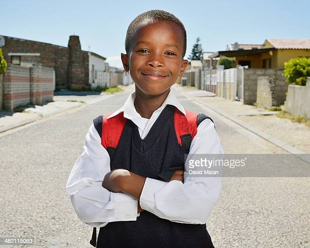 street portrait of schoolboy - schoolboy stock pictures, royalty-free photos & images