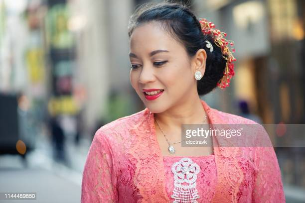 street portrait of woman in traditional outfit - 30代の女性一人 ストックフォトと画像