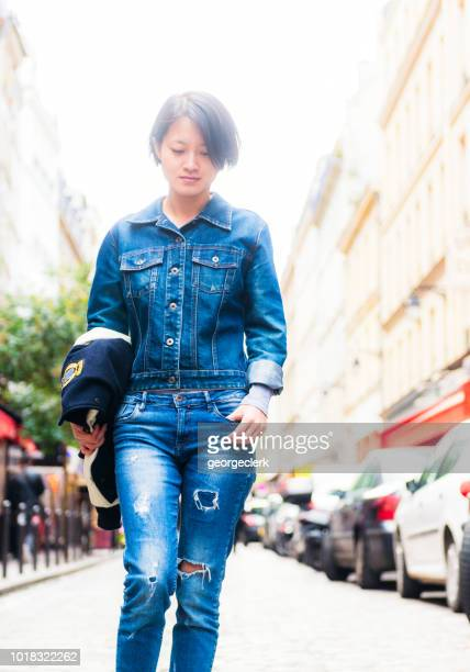 street portrait of woman wearing double denim - double denim stock photos and pictures