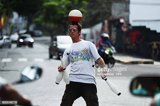 A street prefromer entertains motorists at a busy intersection in the San Antonio district on September 7 2016 in Cali Colombia
