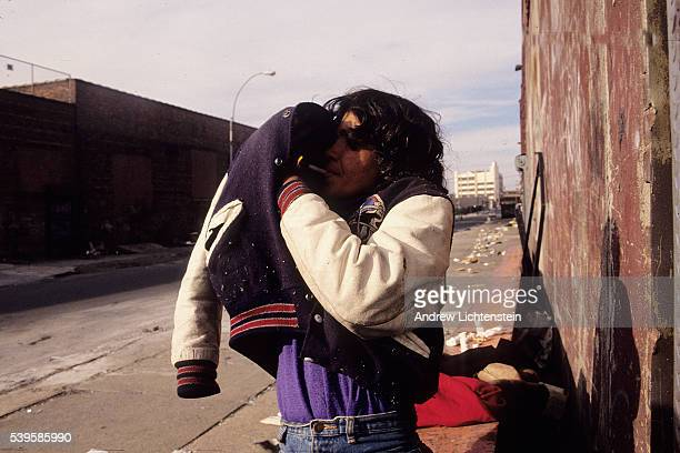 A street prostitute lights her crack pipe on Troutman Street in the brooklyn neighnorhood of Bushwick During the early 1990's it was a common sight...