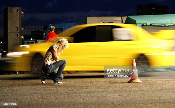 Street racers take off at the Nightpeople Racing Club drag race at Tushino Aerodrome on June 15 2007 in Moscow Russia