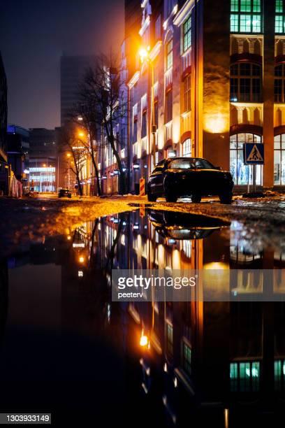 "street reflected in puddle - tallinn, estonia - ""peeter viisimaa"" or peeterv stock pictures, royalty-free photos & images"