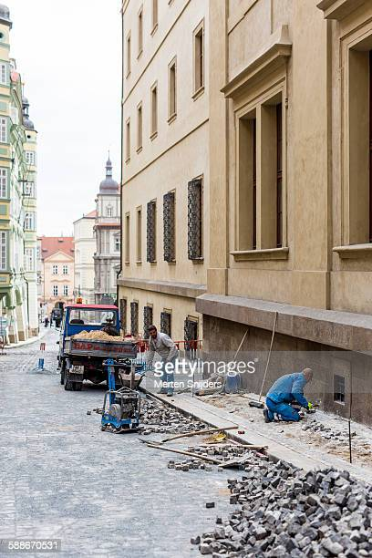 street repair work on nerudova - merten snijders stock pictures, royalty-free photos & images