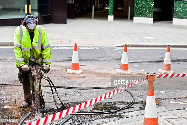Street Repair Worker with jackhammer in London