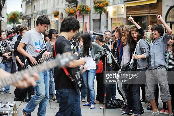 A street rock band performs as teenagers dance on June 21 2011 in Nantes western France during the 30th annual music event 'La Fete de la Musique'...