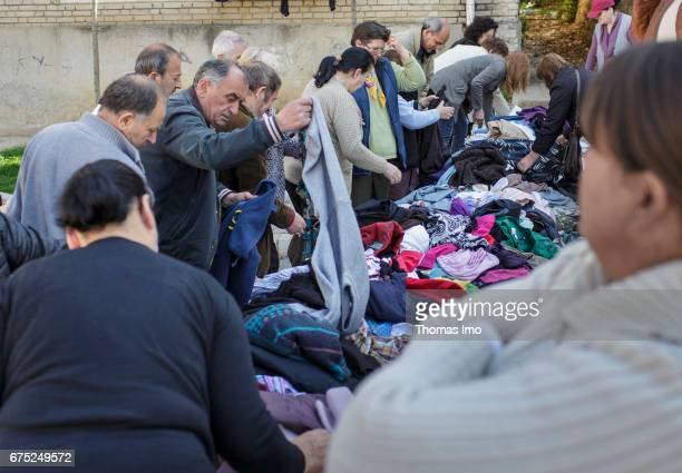 Street sale of clothes on a market Street scene in Tirana Albania on March 28 2017 in Tirana Albania