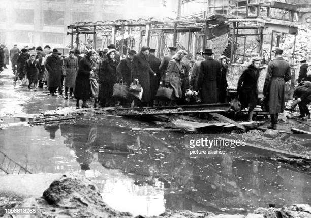 A street scene after the great American air raid to Berlin 03 February 1945 shows people on the destroyed Oranienstrasse street in the Berlindistrict...