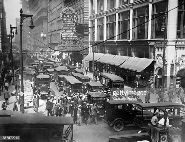 Street scene and trafic jam at the corner of State Street and Madison Avenue in Chicago Illinois circa 1920