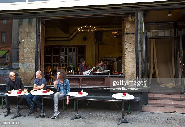 Street scene at Kottbusser Tor problem quarters in BerlinKreuzberg Street Cafe