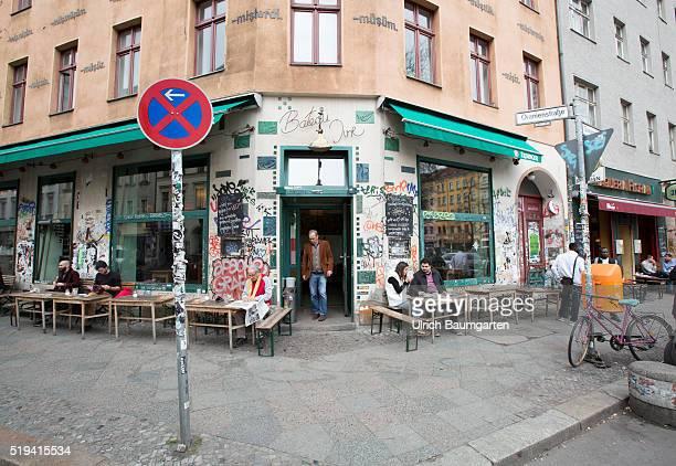 Street scene at Kottbusser Tor problem quarters in BerlinKreuzberg Graffiti on house entrances