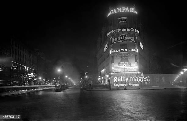 Street scene by night in 1928 in Paris France