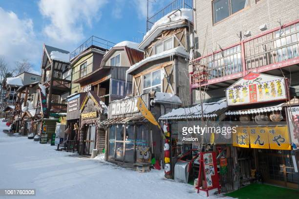 Street scene in Ainu Kotan which is a small Ainu village in Akankohan a street lined by souvenir shops specializing in Ainu handicrafts in Akan...