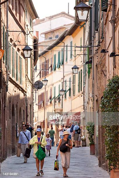 Street scene in ancient hill town of Montalcino in Val D'Orcia Tuscany Italy