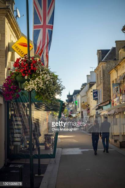 street scene in arromanches-les-bains, normandy france - arromanches stock pictures, royalty-free photos & images