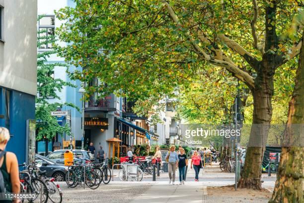 street scene in berlin prenzlauer berg, germany - prenzlauer berg stock photos and pictures