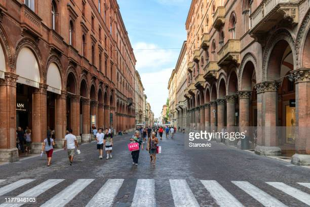 street scene in bologna, italy - emilia romagna stock pictures, royalty-free photos & images