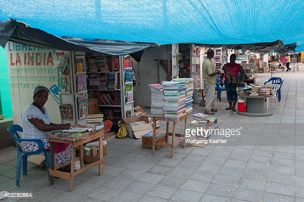 Street scene in Cartagena Colombia with people selling used books