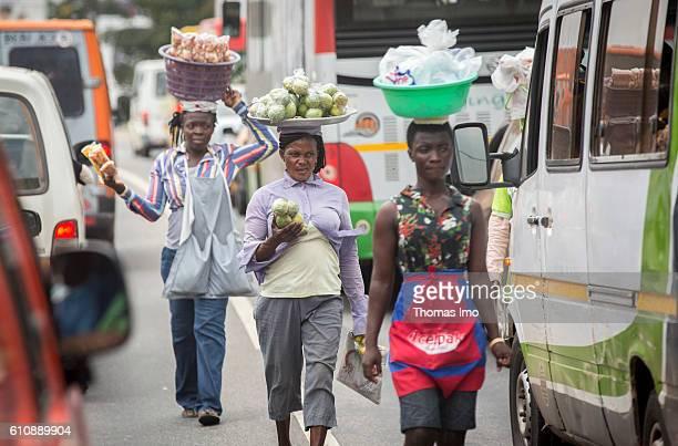 Street scene in Ghana's capital Accra African women transport food on their heads on September 05 2016 in Accra Ghana