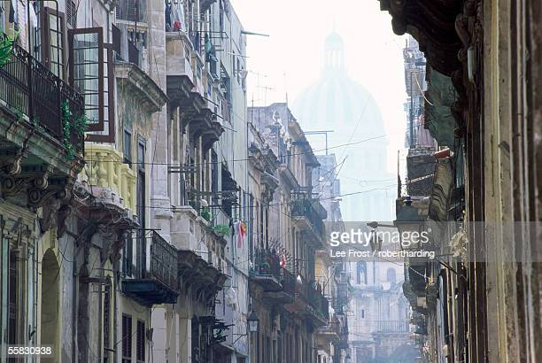 Street scene in Havana Viejo, with Capitolio Nacional in background, Havana (La Habana), Cuba, West Indies, Central America
