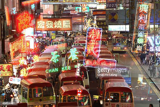 Street Scene in Mongkok. Colorful shopping street Illuminated at night. Mongkok is a district in Hong Kong and has the highest population density in...