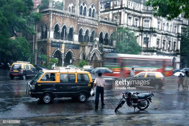 Street scene in monsoon rain, Bombay, Mumbai, Maharashtra, India