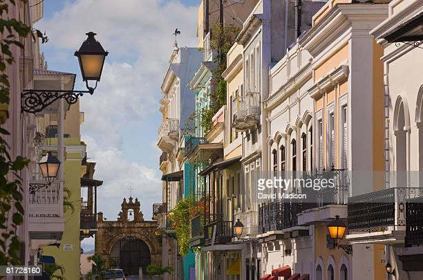 street scene in san juan puerto rico with city gate in background. - old san juan stock pictures, royalty-free photos & images