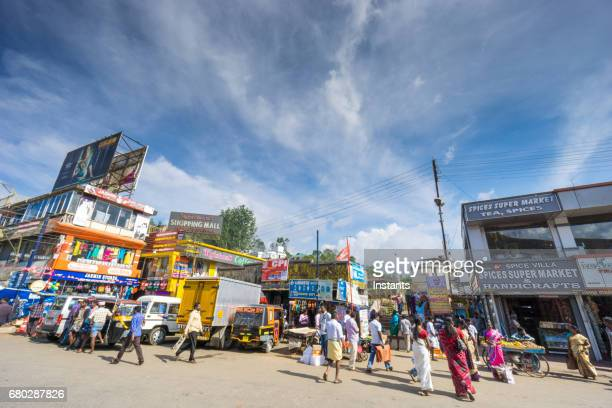 a street scene in the indian city of munnar, situated in south india's kerala region, where people and buildings are visible in the image. - kerala stock pictures, royalty-free photos & images
