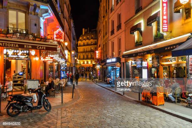 Street scene in the Latin Quarter at night - Paris