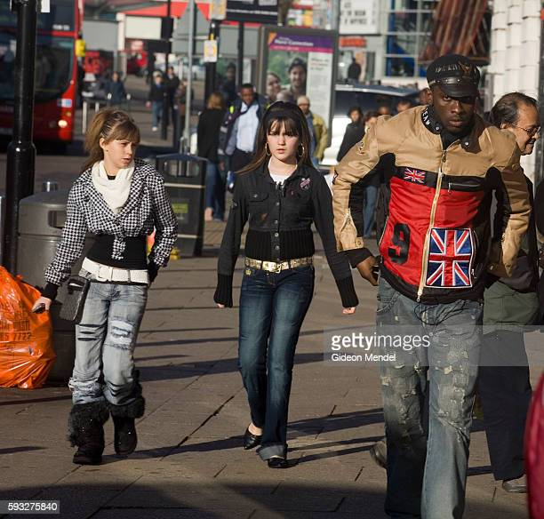 A street scene in the Wood Green shopping area showing people from a wide variety of ethnic and cultural backgrounds This is in London's Haringey...