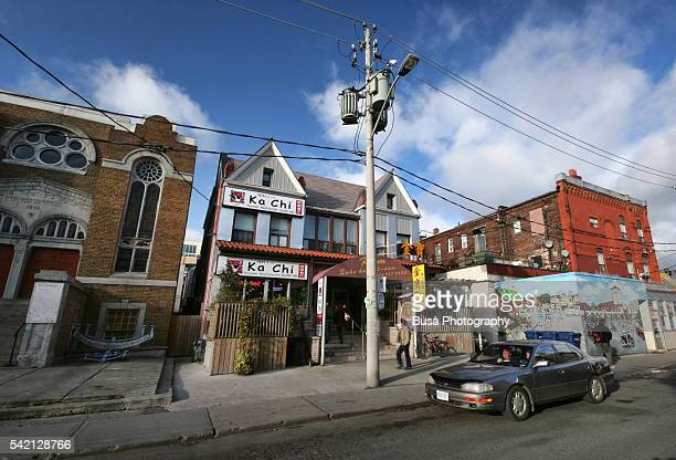 Street Scene in Toronto Kensington Market. Its approximate borders are College St. on the north, Spadina Ave. on the east, Dundas St. W. to the south, and Bathurst St. to the west.