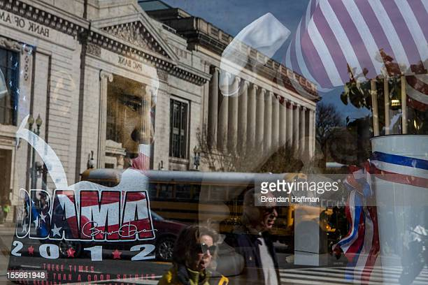 A street scene is reflected in the window of a gift shop near the White House on November 6 2012 in Washington DC As Americans go to vote recent...