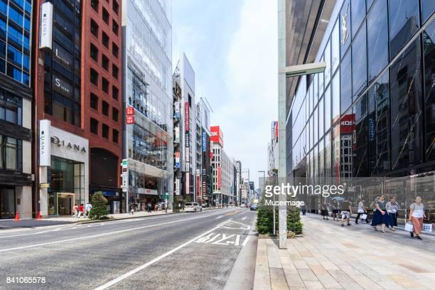 street scene of chuo dori (street) - chuo dori street stock photos and pictures