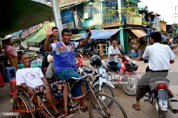 Street scene of daily life for a group of cyclo and motorcycle taxi at a crossroads in Mawlamyine it was the first capital of British Burma in the...