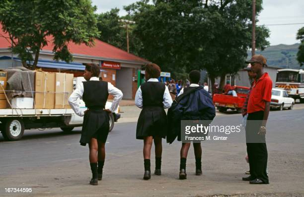 Street scene of local girls walking home from school near Grey Town Durban South Africa February 1997