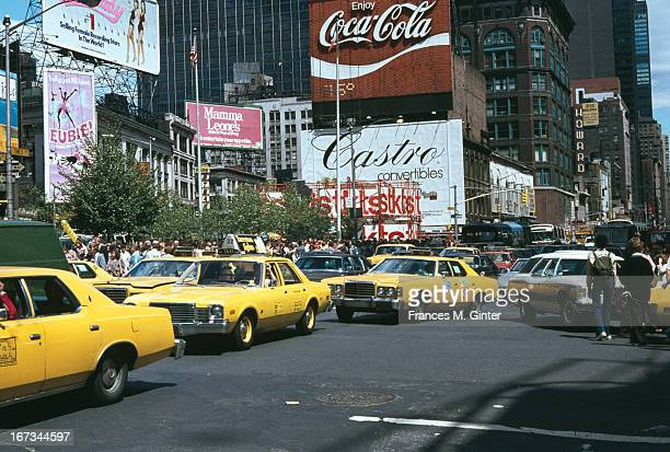 Street scene of Midtown Manhattan looking North towards Times Square NYC August 1979