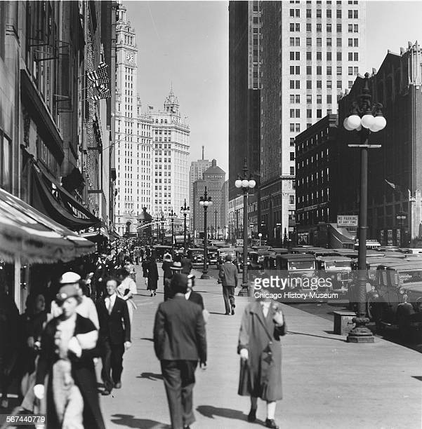 Street scene of North Michigan Avenue looking north featuring views of pedestrian and automotive traffic as well as the Wrigley Building the Allerton...