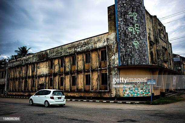 Street scene of of a new car driven by an old theater in Mawlamyine it was the first capital of British Burma in the 19th century It's the main city...