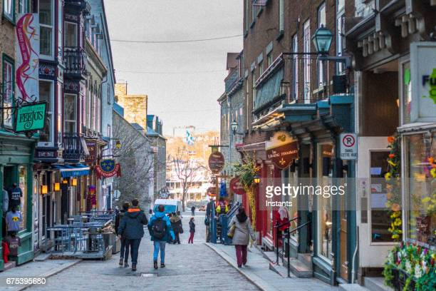 Street scene of Petit Champlain district in Old Quebec city where historical buildings, dating as far back as the 1608, are visible in the image.