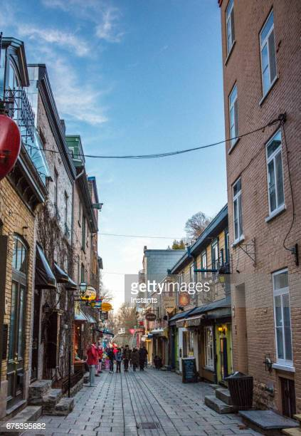 street scene of petit champlain district in old quebec city where historical buildings, dating as far back as the 1608, are visible in the image. - old town stock pictures, royalty-free photos & images