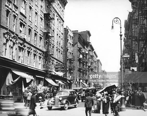 A street scene on Grand Street and Mott Street on Manhattan's Eastside New York New York early to mid 20th century