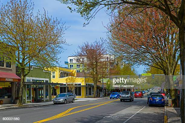 street scene on greenwood avenue, greenwood neighborhood of seattle - greenwood stock photos and pictures